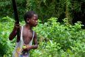 Ir a Foto: Niño Palenquero - Cartagena de Indias  Go to Photo: Child with machete peeling oranges in Palenque